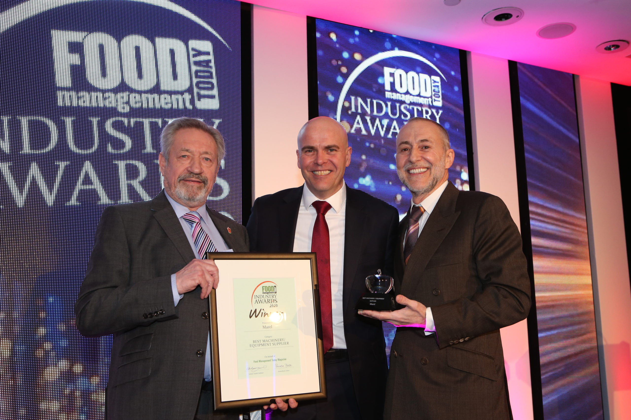 "Institute of Meat CEO Keith Fisher presenting the award for ""Best Equipment / Machinery"" at the Food Management Awards Today"